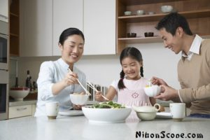 Thin Japanese Family Eating Together